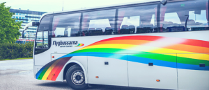 Gray bus with rainbow decal. Photo.