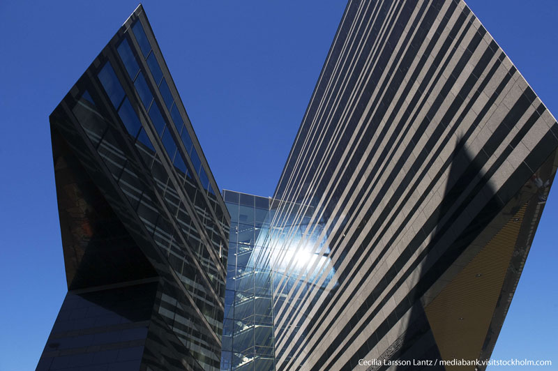 View of arcitetural building against blue sky. Photo.